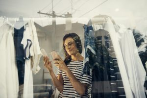 Shot of a shopper using her cellphone while looking at a price tagimage806285.jpg